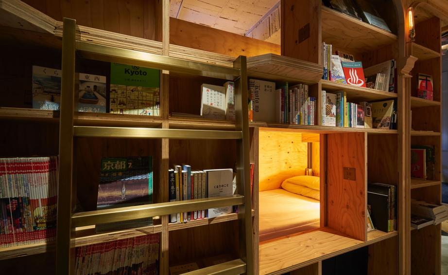 Book and bed, concept hostel in Giappone