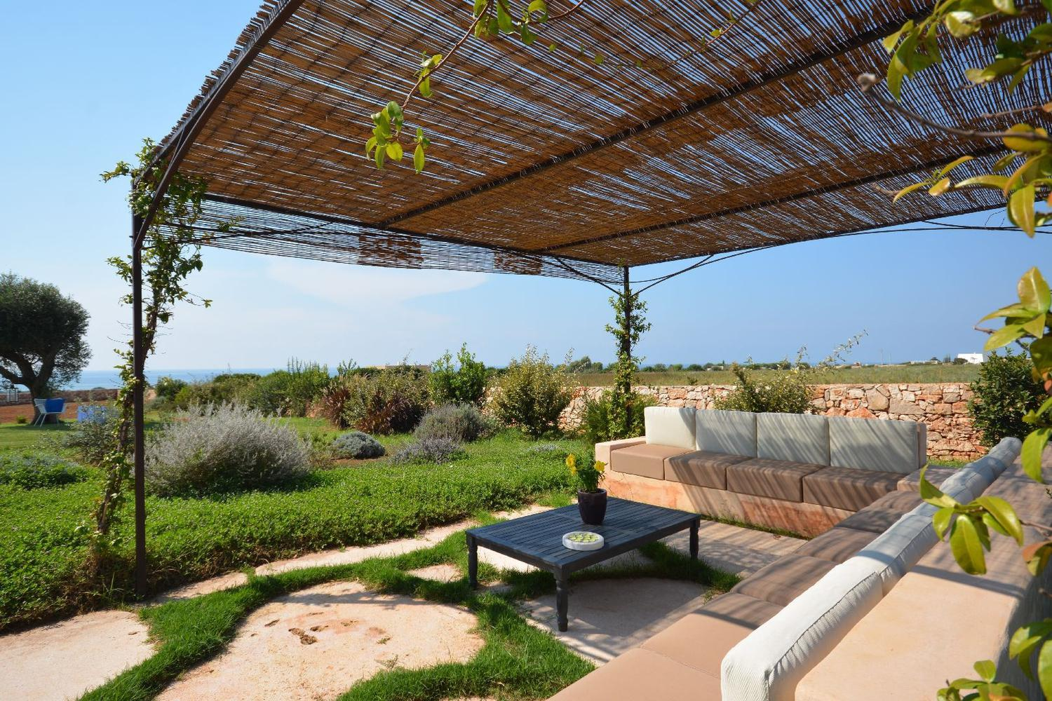 Pergola with sofas and sea view