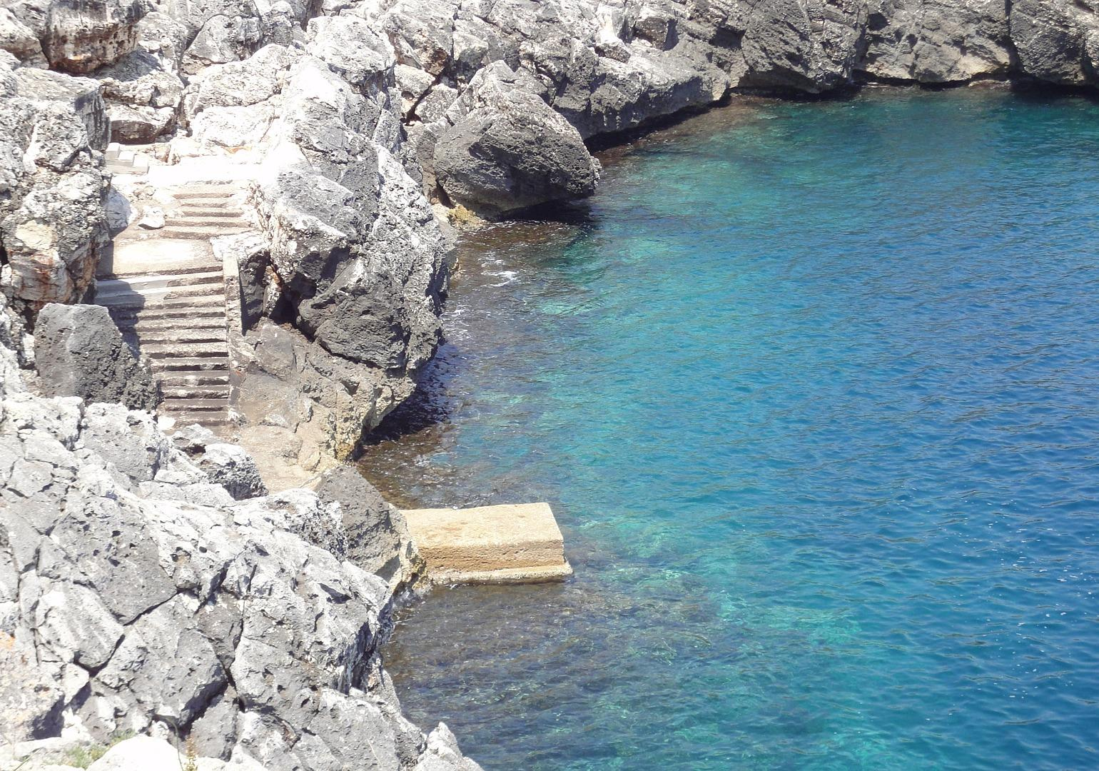 comfortable private rock cove with platform and stairs to enter the water