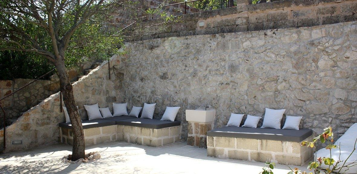 Lower level outside stone made sofa
