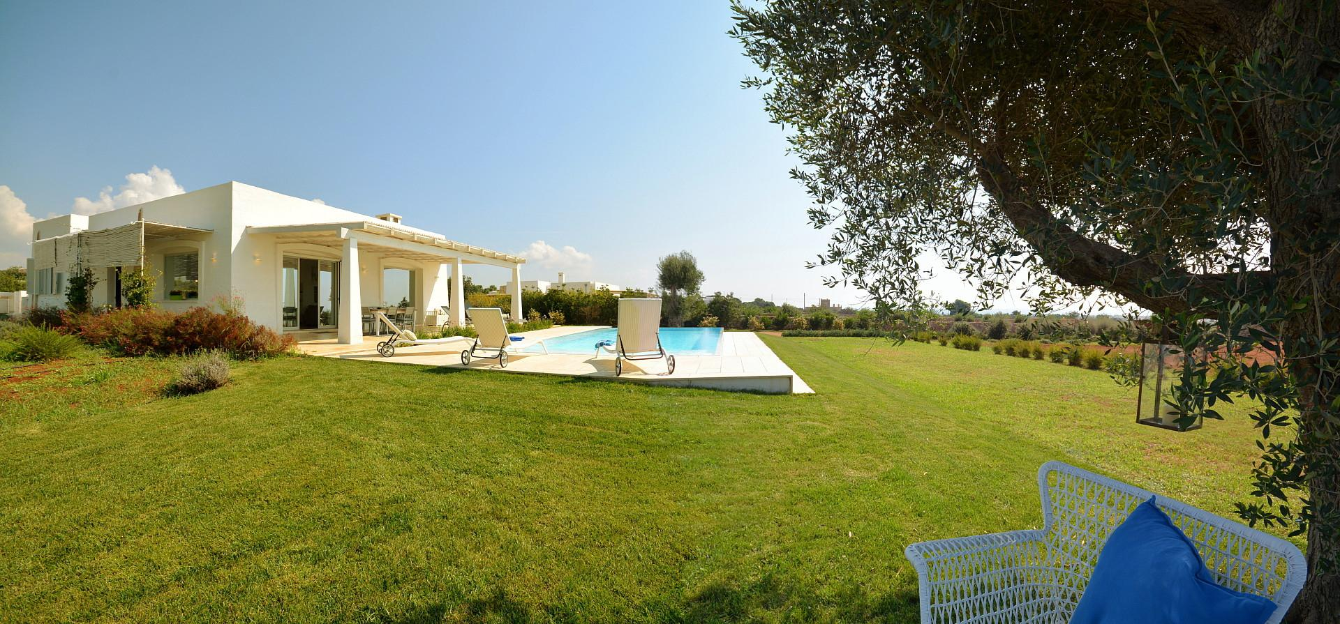 The villa- the pool the garden and the sea view